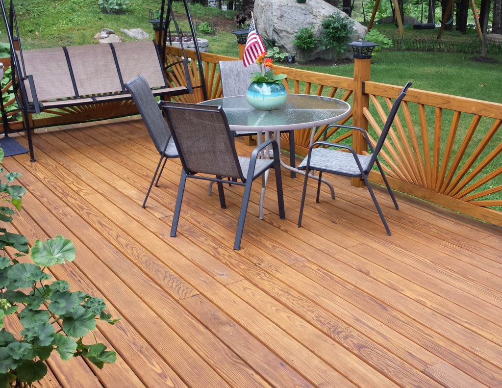 Back deck with fan spoke railing treated with Outlast® CTA Products