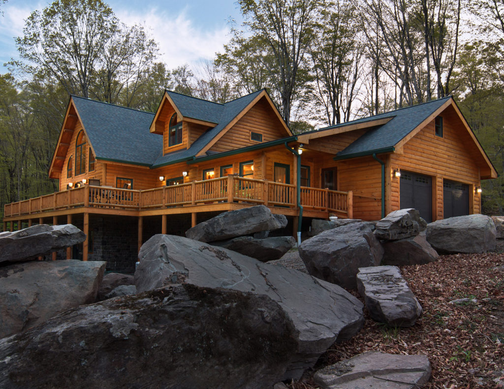 Large log cabin with wrap-around deck treated with Outlast® CTA Products