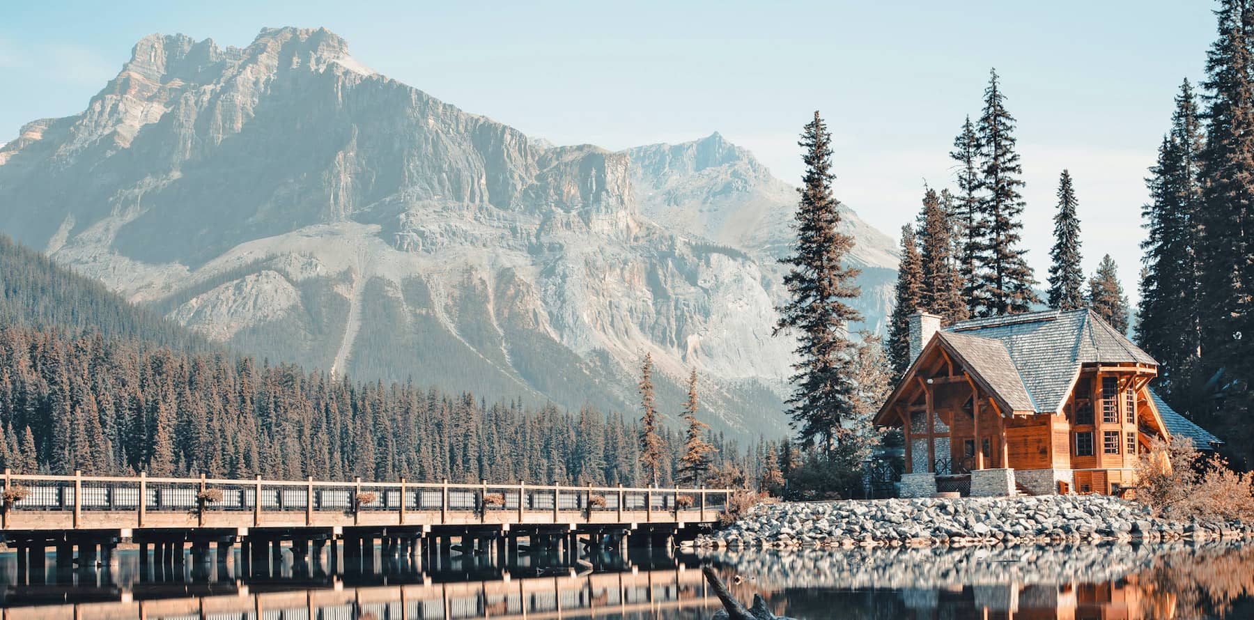 Large log home against the backdrop of large mountains - Outlast® CTA Products