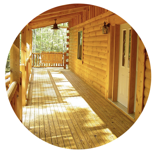 Long log cabin porch treated with Outlast® Q8 Log Oil for decks and fences
