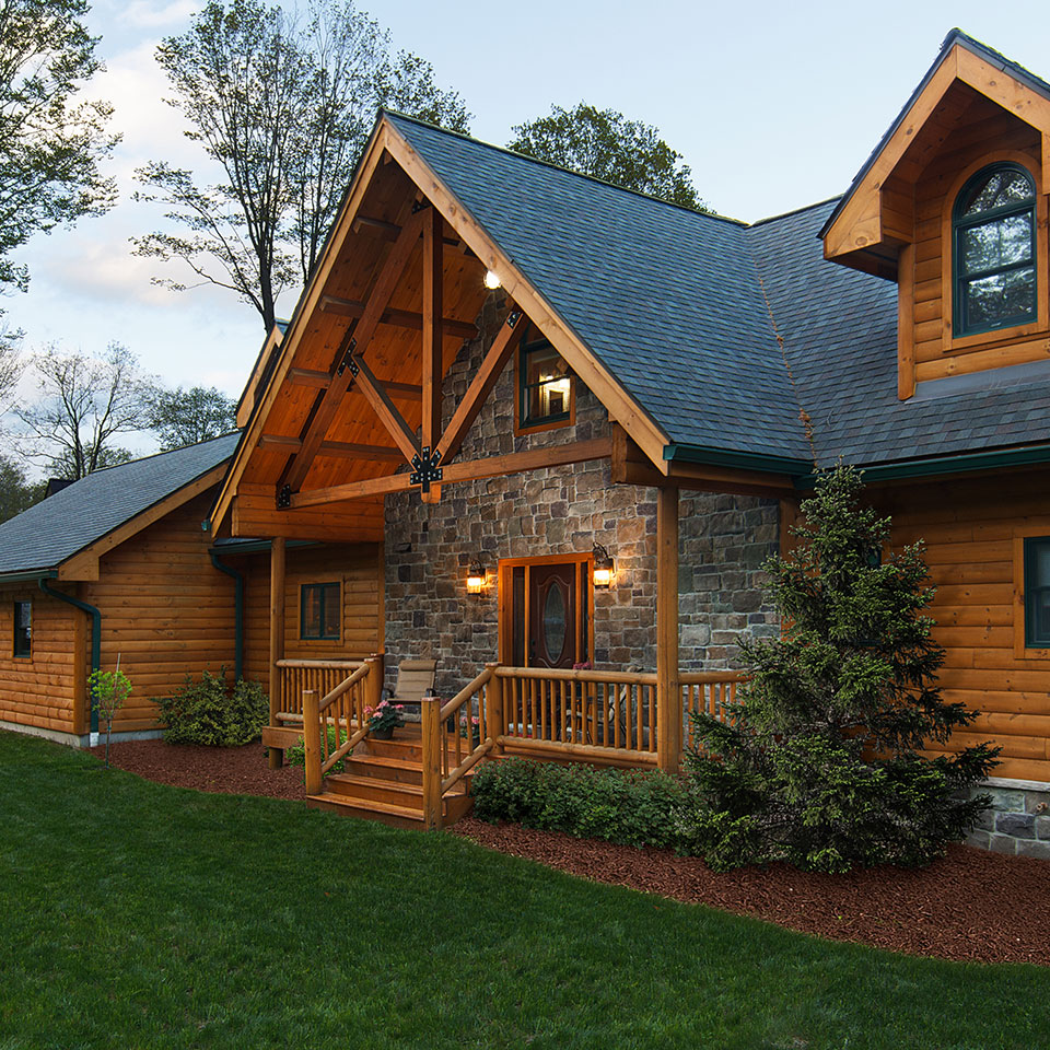 Large log cabin treated with Outlast® Q8 Log Oil CTA Products